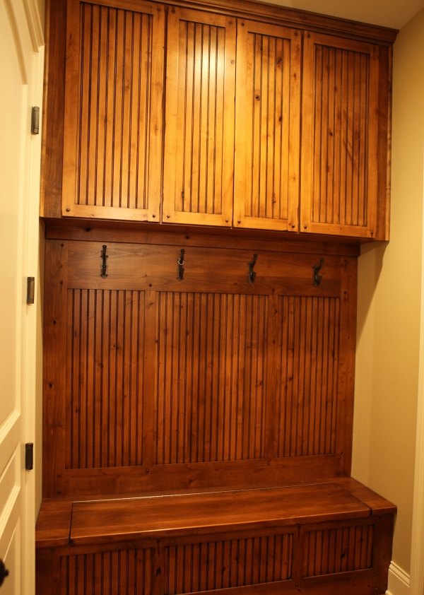 Mudroom with Seat Bench - Walnut Cabinetry - by Battaglia Homes