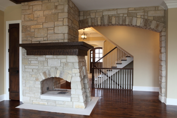 Three-sides-Stone-Fireplace-by-Battaglia-Homes-Hinsdale, IL
