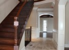 Main Hallway - Milled Cherry Wood Staircase with Iron Baluster