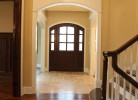 Hallway - White Birch Hardwood Floors, Cased Opening, Travertine Stone Tile