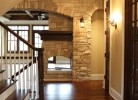 Hallway - White Birch Hardwood Floors & Stone Wall with Arched Detail