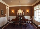 Dining Room with Wainscoting and Chandelier