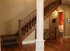 Hallway - Walnut Hardwood Floors & Milled Walnut Wood Staircase
